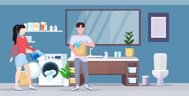 Homme femme, à, panier vêtements, couple, chargement, lessive, à, machine à laver, faire, ménage, ménage, concept, moderne, salle bains, intérieur, dessin animé, caractère, pleine longueur, plat, horizontal