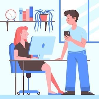 Homme et femme parlant dans l'espace de coworking