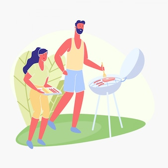 Homme et femme, saucisses rôties et viande barbecue,