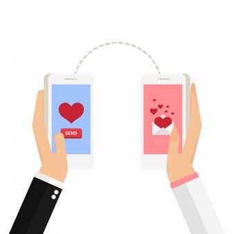 Homme et femme tiennent un téléphone avec un coeur