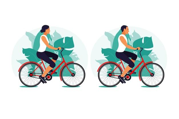 Homme et femme sur un vélo dans le parc
