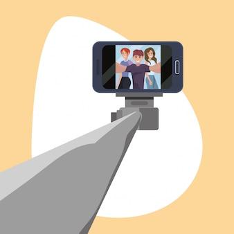 Homme avec des femmes prenant un bâton selfie