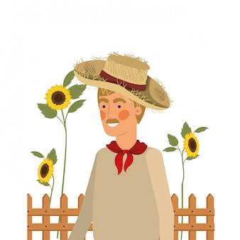 Homme fermier avec chapeau de paille et tournesols