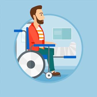 Homme avec une jambe cassée assis dans un fauteuil roulant.