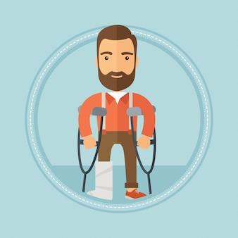 Homme avec une jambe cassée et des béquilles