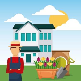 Homme jardinier dans la maison de jardin avec une pelle et un sac d'engrais