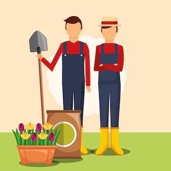 Homme jardiniers avec pelle terreau et fleurs en pot