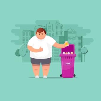L'homme jette des ordures dans un conteneur bio