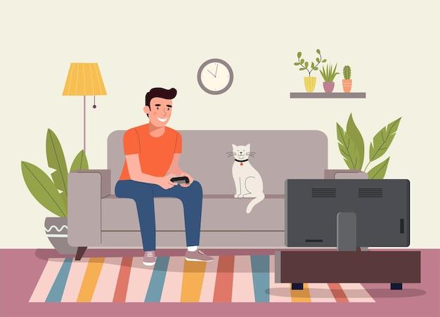 Homme jouant au jeu vidéo sur le canapé