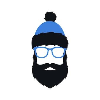 Homme en lunettes de chapeau bleu d'hiver et avec barbe