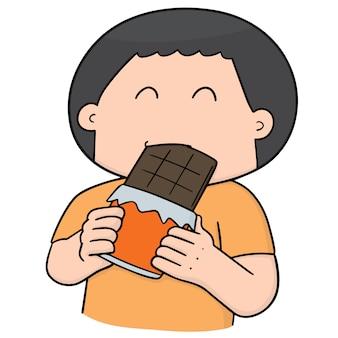 Homme mangeant du chocolat