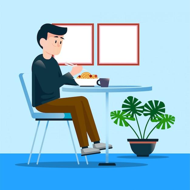Homme mangeant des ramen au restaurant