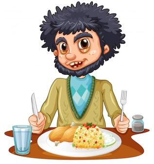 Homme mangeant des repas sur la table