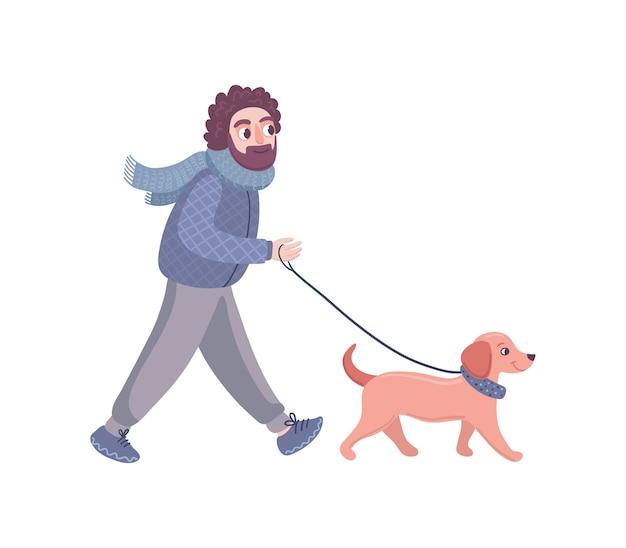 Un homme marche avec un chien teckel