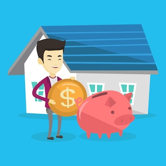 L'homme met de l'argent dans sa tirelire pour acheter une maison.