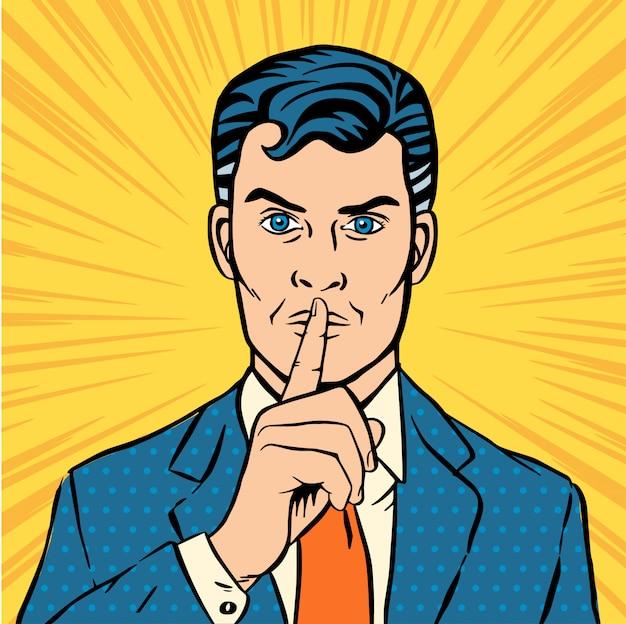 Homme mettant son index sur ses lèvres pour un silence silencieux.