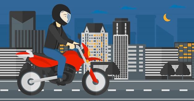 Homme à moto.