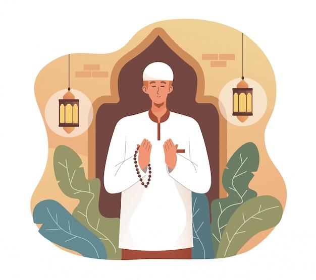 Homme musulman priant tout en tenant des chapelets