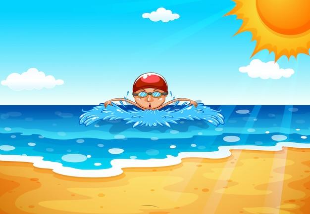 Homme nageant dans l'océan