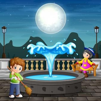 Un homme nettoie le parc de la ville la nuit illustration