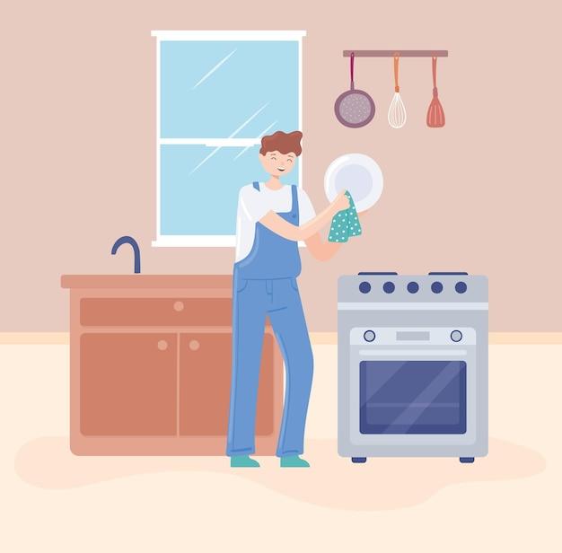 Homme nettoyant dans la cuisine