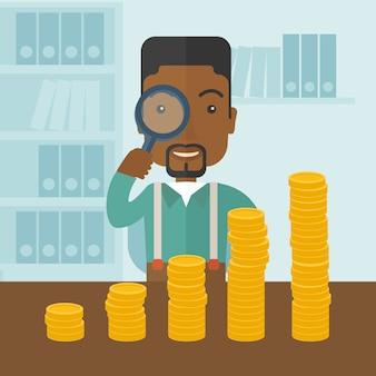 Homme noir en regardant son entreprise en pleine croissance à l'aide de la loupe.