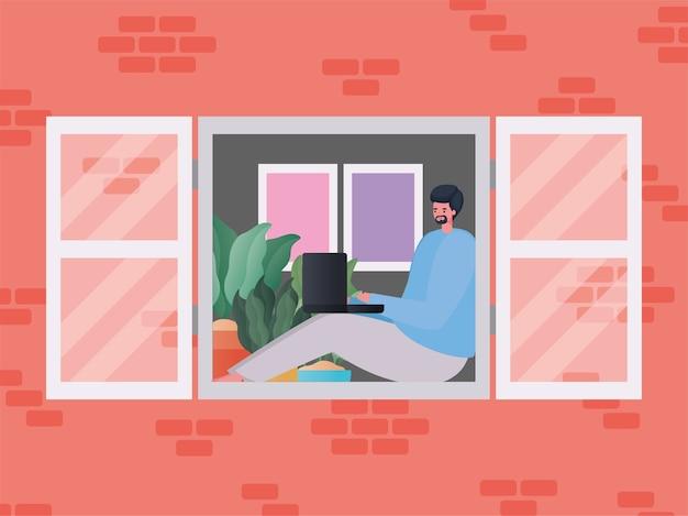 Homme avec ordinateur portable travaillant à la conception de la fenêtre de travail à partir du thème de la maison