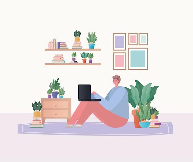 Homme avec ordinateur portable travaillant sur la conception de tapis de travail à partir du thème de la maison