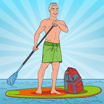 Homme pagayer sur stand up paddle board