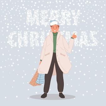 Homme avec paquet de noël homme portant en bonnet de noel sur fond de neige joyeux noël concept