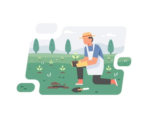 Un homme plante un arbre