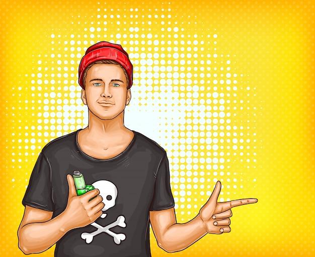 Homme de pop art en t-shirt, chapeau tenant vape avec expression satisfait pointant avec le doigt