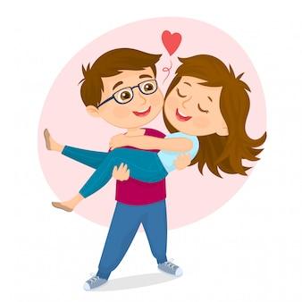 Un homme portant une belle fille dans ses bras