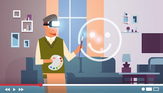 Homme portant des lunettes vr casque peintre art blogueur avec pinceau et palette dessin réalité virtuelle emoji live streaming vidéo blogging concept portrait horizontal