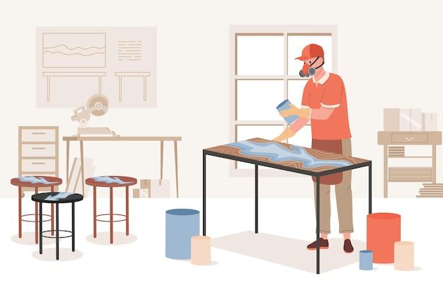 Homme portant un masque protecteur et remplissant une table en bois avec de l'acrylique