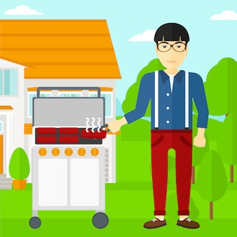 Homme prépare le barbecue