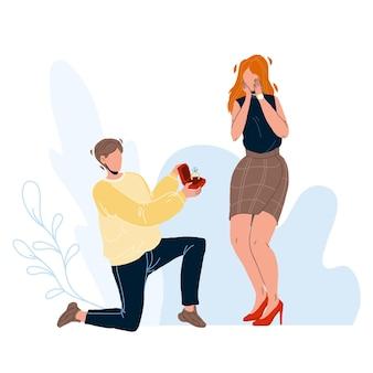Homme proposant une belle femme à épouser le vecteur. jeune garçon proposant le mariage femme surprise. type de personnage avec une bague de fiançailles faisant une proposition à l'illustration de dessin animé plat de petite amie bien-aimée
