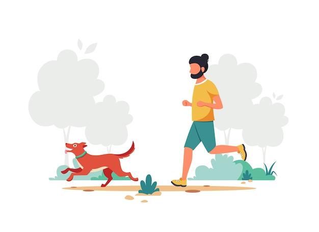 Homme qui court avec un chien dans le parc