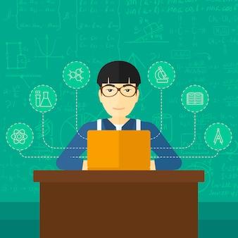 Homme qui étudie avec un ordinateur portable