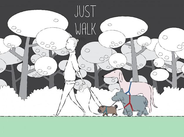 Homme qui marche avec des chiens