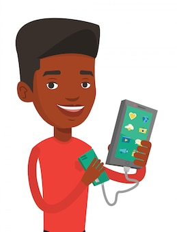 Homme recharge smartphone à partir de la batterie portable.