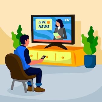 Homme regardant les nouvelles à la maison