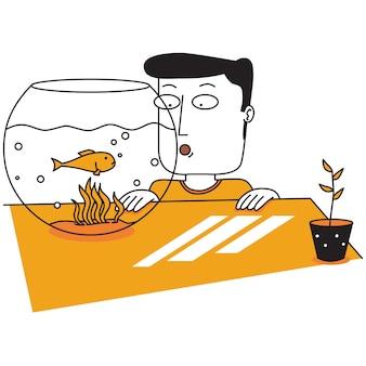 Homme regardant des poissons dans un bocal