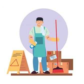 Homme de service de nettoyage avec des gants, des ustensiles de nettoyage et des boîtes