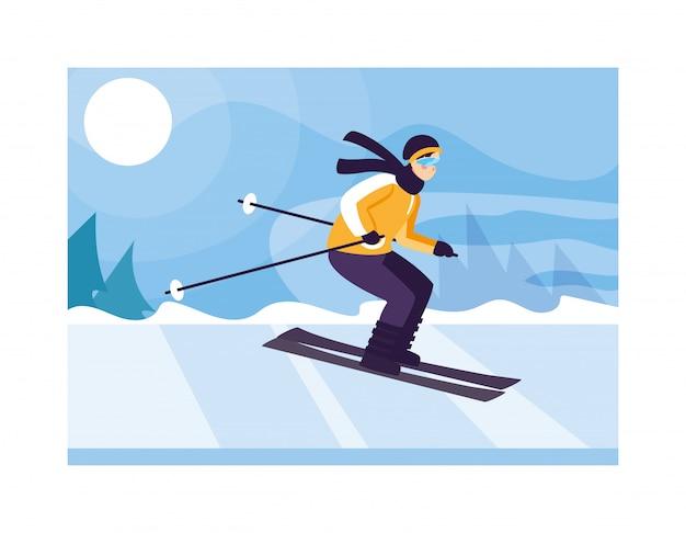 Homme avec ski de montagne dans le paysage avec des chutes de neige
