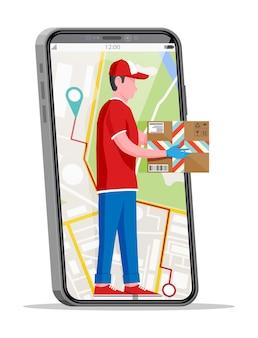 Homme en smartphone tenant une boîte en carton