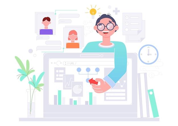Homme à son bureau avec son ordinateur portable.