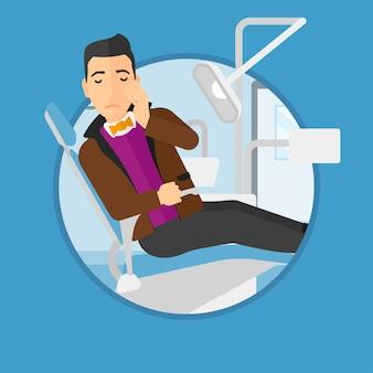 Homme souffrant en fauteuil dentaire.
