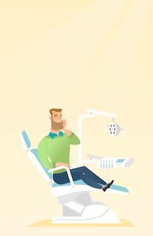Homme souffrant de maux de dents.