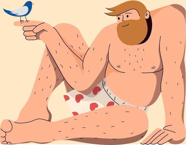 Homme en sous-vêtements tenant un oiseau sur son doigt